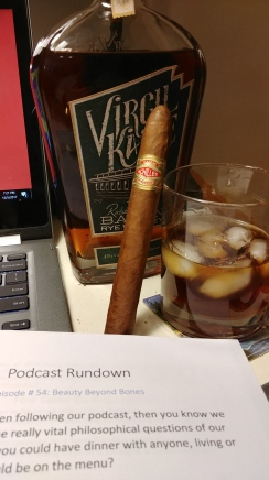 Charles plugging Curivari cigars and Virgil Kaine Rye Whiskey