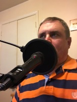 Me trying to take a selfie of me podcasting without me looking at the camera